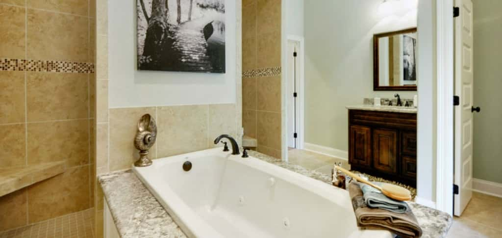 "<p>A jetted soaker tub with granite tub deck sits in front of double-entry shower, creating elegance.<br /> <br /> ""It feels as if they are in a luxury spa in their own home,"" says Siemiontkowski. ""It also gives buyers a feeling of relaxation after a long day at work."" She adds that buyers can upgrade their bathroom with additional shower heads, extra recessed lights or an additional window.</p> <p >PHOTO COURTESY OF<br /> Elliott Homes</p>"