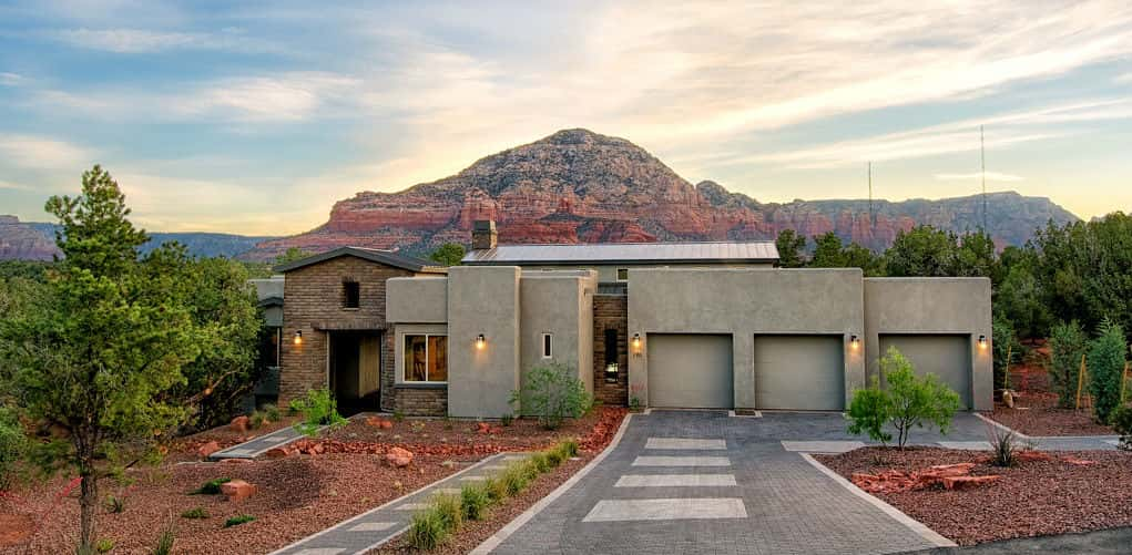 """We oriented the home to take advantage of the beautiful background,"" Jim Gunby, vice president of Dorn Homes, says of the Enchantment plan at RimStone.<br /> <br /> Located in Sedona, Ariz., RimStone is surrounded by scenic red rock formations and high desert landscapes. The temperate climate makes it perfect for outdoor living, which is a centerpiece of this home plan. ""This home works as both an interior and exterior living space,"" Gunby says.<br /> <br /> PHOTO COURTESY OF<br /> Dorn Homes"
