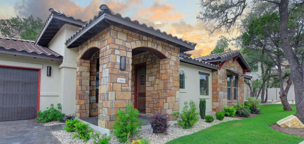 "<p>A three-bedroom, two-bath home, the Nerello plan is a Tuscan-style home idyllically set in the Wildwood community.<br /> <br /> ""We do everything we can to try and preserve the land we build on,"" says Christy Decker, marketing manager for Ash Creek Homes. ""We've been able to save about 82 percent of the area's trees and work around the land's natural topography, creating a uniquely arranged community that highlights the beauty of the land.""</p> <p> </p> <p>PHOTO COURTESY OF<br /> Ash Creek Homes</p>"