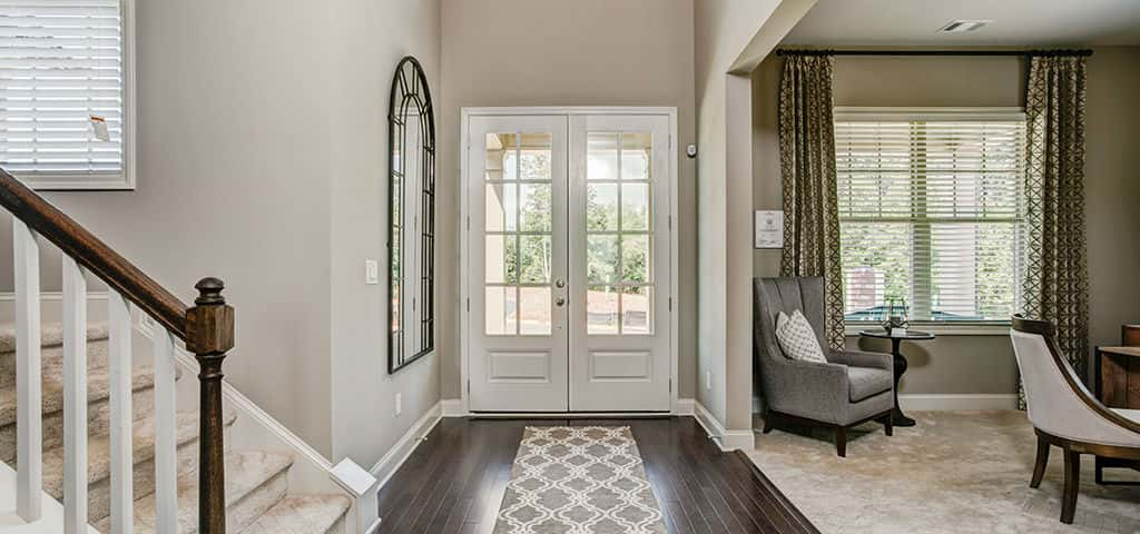"""A gracious beginning to an incredible home, the Prescott's vestibule two-story foyer flanks a private study,"" says Kristen Tapley, a sales associate with FrontDoor Communities. ""The main level magic continues in the ample family gathering and dining areas and open-concept kitchen.""<br /> <br /> Not much of a studier? This area also has an option to add a wet bar area that flows into the family gathering space.<br /> <br /> PHOTO COURTESY OF<br /> FrontDoor Communities"