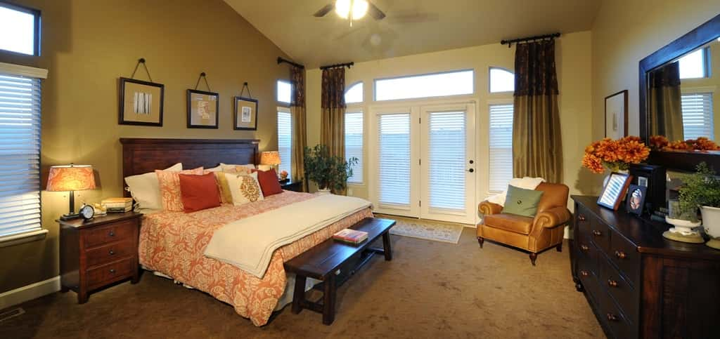 "The main level master bedroom surrounds the owner in luxury touches from plush carpeting to rich linens and elegant furnishings. Large windows let in plenty of natural light and an optional walk-out to the back deck give this room a greater sense of seclusion from the rest of the house.<br /> <br /> ""The master suite truly represents an owner's retreat,"" Sandoval says. ""The spaciousness of this suite offers a sitting area great for reading or just relaxing.""<br /> <br /> PHOTO COURTESY OF<br /> Classic Homes"