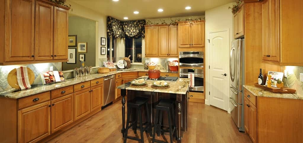 The two-story stone fireplace is two-sided, providing warmth to both the great room and the kitchen — the perfect feature for those Colorado winter nights.<br /> <br /> The kitchen itself has plenty of cabinet and storage space, stainless steel appliances and granite slab countertops, as well as an island with a cooktop. A breakfast nook next to the fireplace makes for a cozy dining option.<br /> <br /> PHOTO COURTESY OF<br /> Classic Homes<br />
