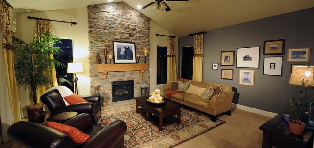 Just off of the kitchen, the family room option offers a more intimate and quiet space for family and friends to gather to watch television, play games or just talk after dinner.<br /> <br /> Wall-to-wall carpeting, natural and warm decorative tones and a smaller stone fireplace combine to create a warm and inviting room.<br /> <br /> PHOTO COURTESY OF<br /> Classic Homes