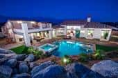 A pool, jacuzzi, covered patio and roof-top deck are highlights in the backyard of Plan 2 by Far West Industries Tuscany Heights; Palm Springs, CA.