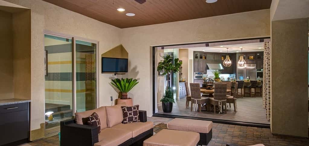 A sliding glass door connects a covered patio to the home's breakfast nook, taking advantage of the temperate Palm Springs weather and the mountain views.<br /> <br /> Brick pavers lead the way from the home's master bedroom to the patio, where an outdoor kitchen and patio furniture provide a place to dine al fresco.
