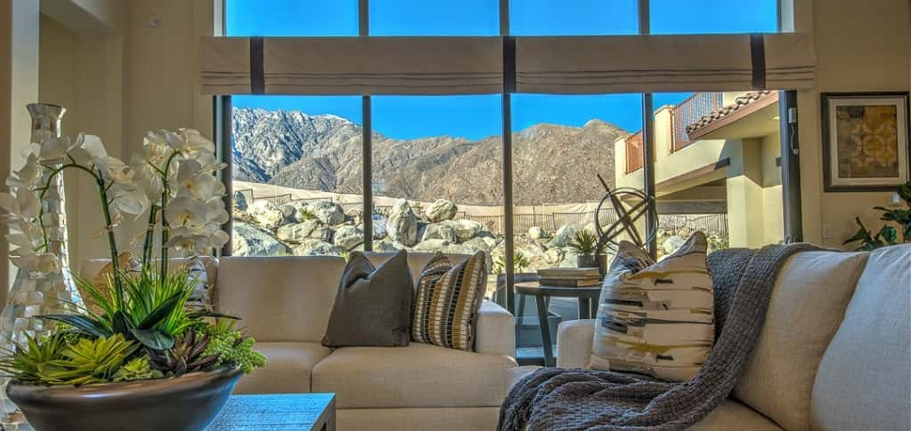 A wall of windows in the home's living room provides not only plenty of natural sunlight, but spectacular views of the San Jacinto Mountains.<br /> <br /> This open-concept room is light and spacious, providing more entertaining space in the home. The room is also a pleasant place to enjoy an afternoon nap.