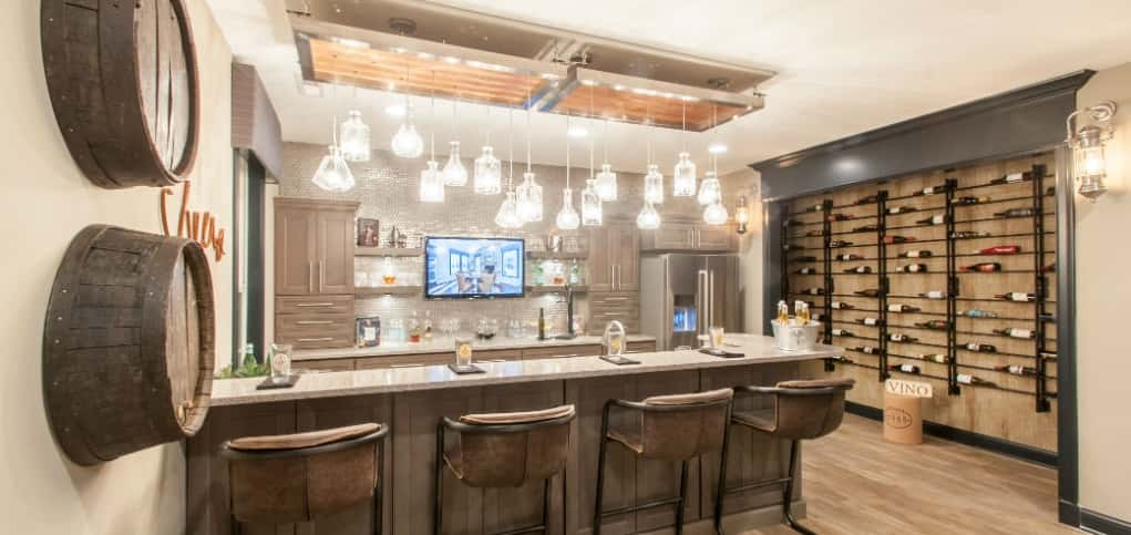 "Rookwood Plan<br /> Overbrook Farms; Carmel, Indiana<br /> 3 bedrooms/2 baths<br /> 3 garages<br /> 3,167 sq. ft.<br /> <br /> Photo: A built-in bar in the home's finished basement is a nice touch on this rec space.<br /> <br /> PHOTO COURTESY OF<br /> Fischer Homes<br /> <br /> <a href=""https://www.newhomesource.com/homedetail/planid-1222442"" target=""_blank"">See More Photos of This Home on New Home Source</a>"