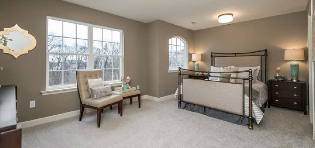 <p>A secondary bedroom is generously sized and has a walk-in closet.<br /> <br /> Two large divided, double hung windows and a smaller arched window provide lots of natural sunlight into this second-floor retreat.</p> <p >PHOTO COURTESY OF<br /> Fischer and Frichtel</p>