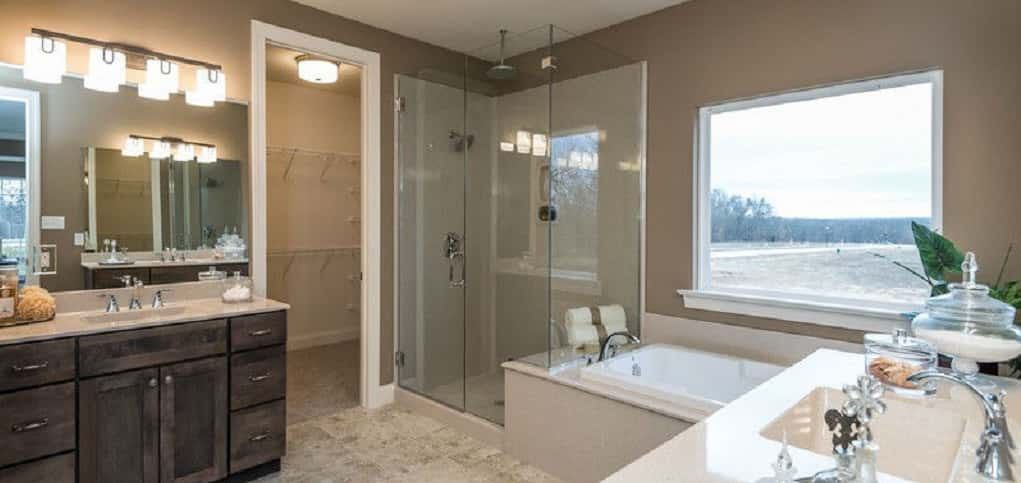 "<p>A glass-encased shower with a rain showerhead, soaker tub and his-and-her vanity are just some of the features in this spacious master bath.<br /> <br /> To further up the luxe factor, Horton says buyers often take out the tub and eliminate the shower door to create a walk-in shower. ""They also add body sprays and/or rain shower heads to enhance the showering experience.""</p> <p >PHOTO COURTESY OF<br /> Fischer and Frichtel</p>"