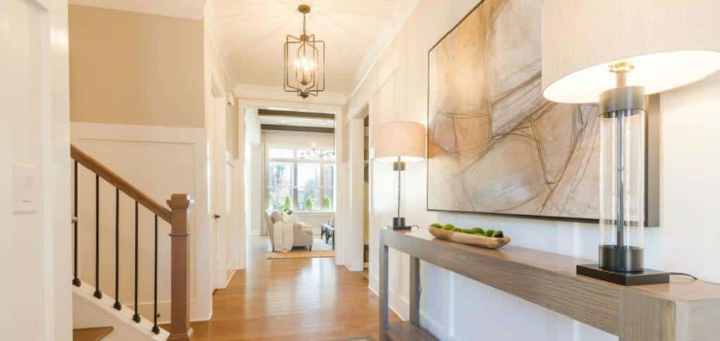 """Foyers are important to today's homebuyer because they are the first impression when entering the home,"" says Wiggins.<br /> <br /> In this model, wainscoting in the foyer makes a statement that will leave guests excited to see the remainder of the home.<br /> <br /> PHOTO COURTESY OF<br /> Edward Andrews Homes"