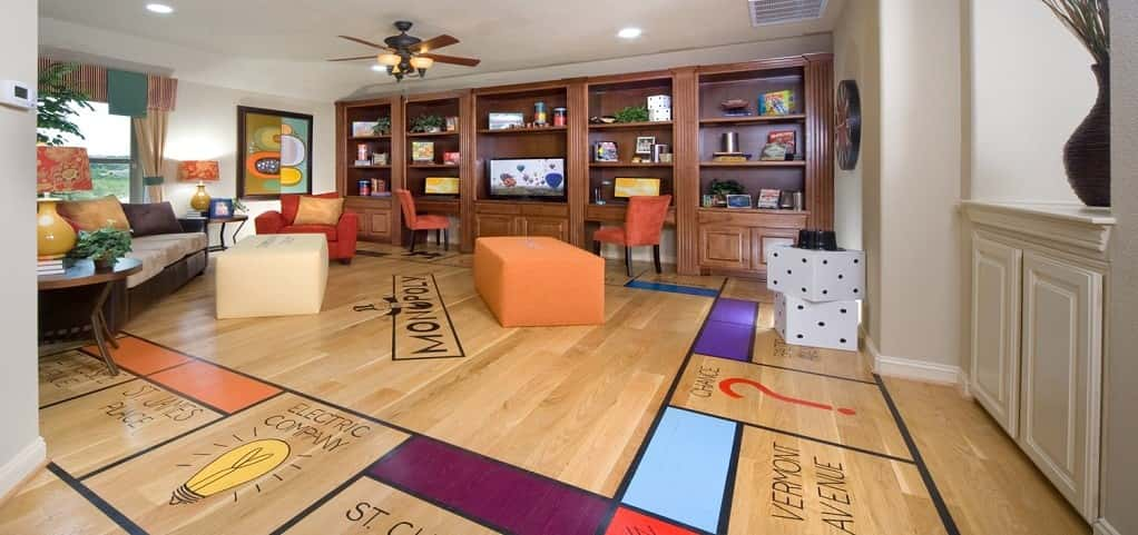 "Rounding out the list is this game room design from <a href=""https://www.newhomesource.com/resourcecenter/slideshows/home-of-the-week-dartmouth-plan-by-gehan-homes"" target=""_blank"" title=""Gehan Homes"">Gehan Homes</a>. It's not often that you see a game claim a monopoly over a room like this. Complete with a life-size game board, ""Community Chest"" and ""Chance"" card cushions, it's a Monopoly fan's heaven. This space indubitably puts the ""game"" in game room.<br /> <br /> PHOTO COURTESY OF<br /> Gehan Homes"
