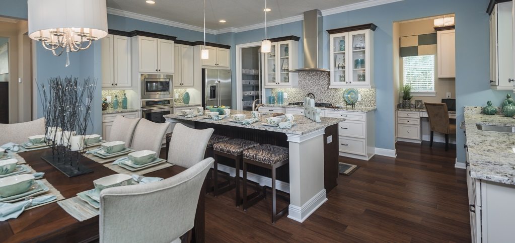 "Cool blue tones and white marble countertops combine in the Carringtons kitchen by <a href=""https://www.newhomesource.com/builder/greenpointe-homes/about/8142"" target=""_blank"" title=""GreenPointe Homes"">GreenPointe Homes</a>. Tucked behind the stainless steel refrigerator is a pantry, perfect for storing food items and appliances alike. A sink and separate wet bar are ideal for entertaining guests and keeping clutter out of the way and for more quiet days, the tech nook is a practical space for checking email or charging electronics.<br /> <br /> PHOTO COURTESY OF<br /> GreenPointe Homes<br /> <br /> <a href=""https://www.newhomesource.com/communityresults/market-80/brandid-8142"">GreenPointe Homes in Brooksville, Fla.</a>"