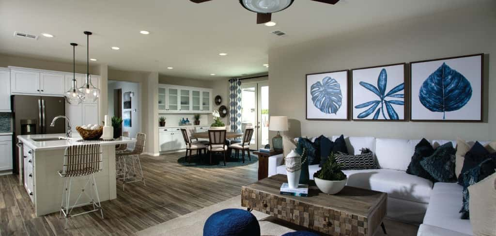 """The open floor plan is conducive to large family get-togethers,"" says Orr. She added that many buyers choose a sectional couch to allow for family-style sitting and entertaining guests.<br /> <br /> Spaciousness doesn't end with the common areas, however: with four bedrooms, the Iron Horse Plan offers plenty of room and privacy for the whole family. For those that entertain, a downstairs guest room is the perfect spot for family and friends to stay the night. An upstairs loft can also be adapted to fit your family's needs, whether that's an office, a playroom or something else entirely.<br /> <br /> <strong>Photo Courtesy of</strong><br /> Comstock Homes"