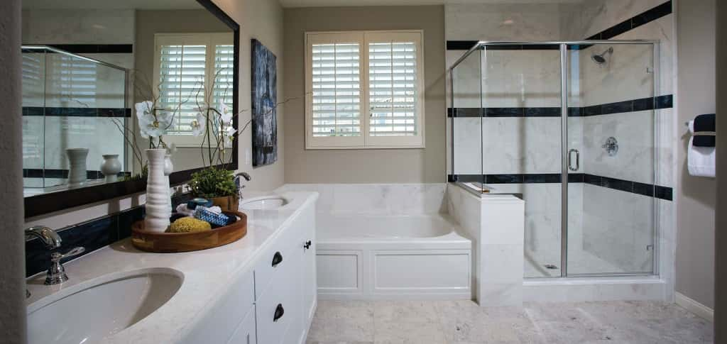 The elegant owner's bathroom packs spa-quality features into an airy room full of natural light. As with the rest of the home, buyers can choose to upgrade finishes to fit their personal style.  <br /> <br /> No matter how you choose to style the owner's bath, the soaking tub promises the opportunity to relax and wash away your worries. Feel free to hog the counter too, because double sinks eliminate any concerns over having to share precious space!<br /> <br /> <strong>Photo Courtesy of</strong><br /> Comstock Homes