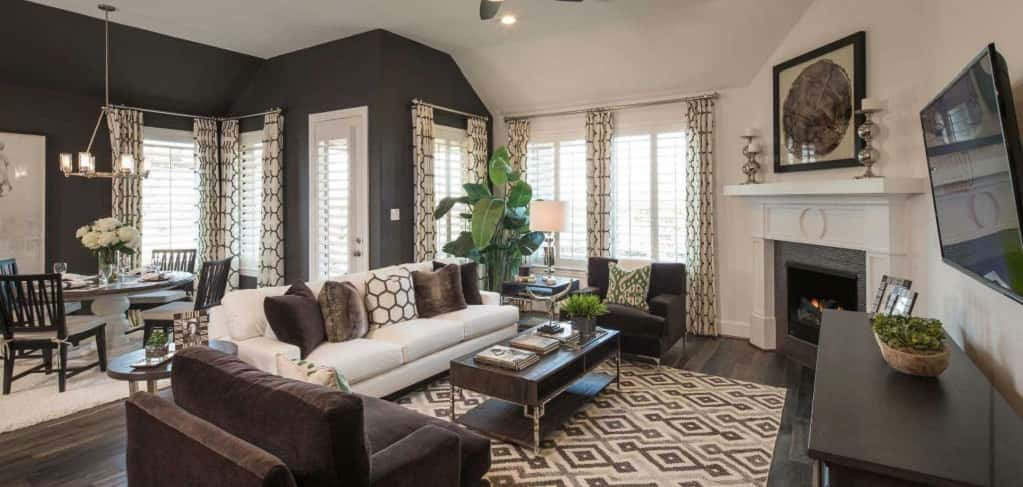 "Kudos to the designer of this model home, who uses lots of texture, color and intricate details, like the paneling above and the tiling around the fireplace, which comes standard (though, design details are not).<br /> <br /> What do buyers love about this space? ""There is a lot of light let in and you are not separated from someone cooking in the kitchen or sitting at the breakfast table,"" Amore. ""It allows for busy people and families to interact more with each other.""<br /> <br /> <strong>Photo Courtesy of</strong><br /> Highland Homes"