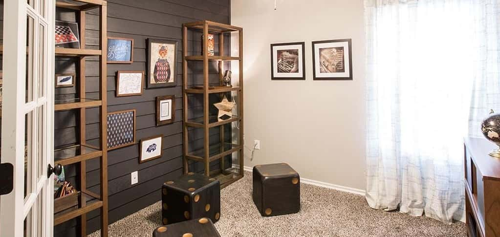 Whimsical décor, like dice-shaped wood stools and wood art and a fox dressed in hipster-cool attire, makes this home study a fun place to get work done.<br /> <br /> A shiplap accent wall painted in a gray-black provides a perfect canvas for artwork. This space can also be used as an additional bedroom, providing more living space and a comfortable spot for visiting guests.<br /> <br /> <strong>PHOTO COURTESY OF</strong><br /> Ideal Homes