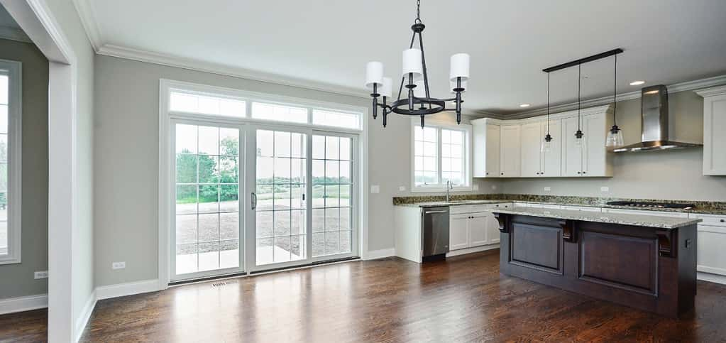 <p>A wall of windows and sliding glass door (both are standard in the home) bring plenty of natural lighting to the home's breakfast room.<br /> <br /> Hardwood floors and crown molding are standard in this space, creating a warm effect for large family gatherings or smaller, intimate meals.</p> <p> </p> <p>PHOTO BY<br /> VHT Studios</p>