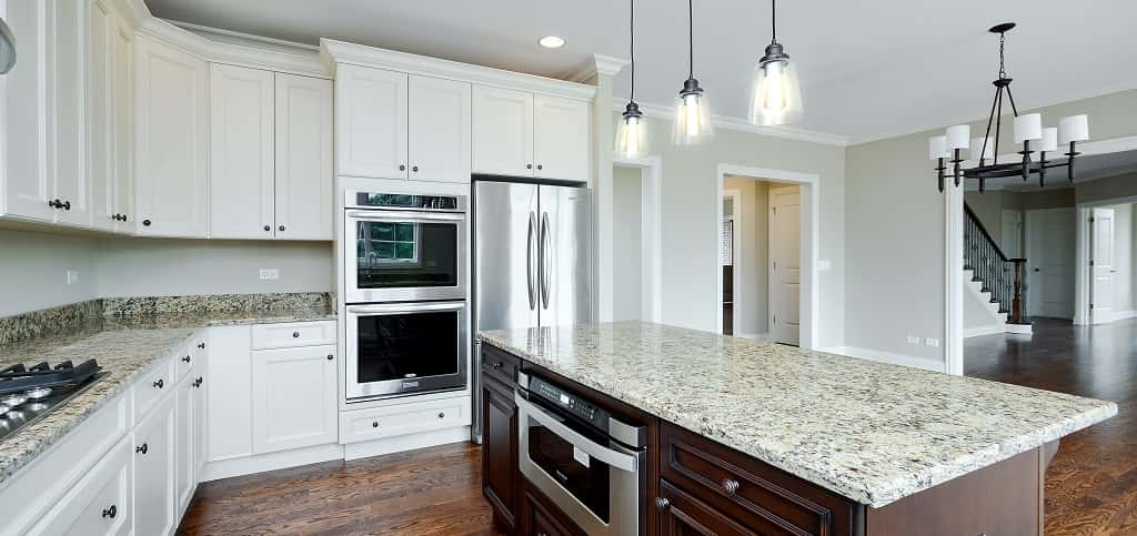 "<p>The Oak's U-shaped kitchen has plenty of storage and a large island with a standard granite countertop to anchor the room and for quick meals and food prep, Daiberl says.<br /> <br /> Buyers especially appreciate the amount of storage in the kitchen and the butler and storage pantries, she says. KitchenAid appliances come standard, however, many buyers opt to upgrade the hood and countertop to ""better suit their individual cooking needs and personal taste,"" she says.</p> <p> </p> <p>PHOTO BY<br /> VHT Studios</p>"