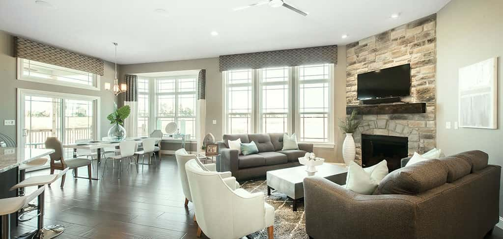 """The great room is the ideal spot for gathering with friends or as a family,"" says Perry of the home's open floor plan. ""The stone fireplace adds an element of warmth and comfort to the room, creating a warm, inviting space for all who enter the home.""<br /> <br /> Indeed, the open floor plan of the family room, breakfast nook and kitchen emphasizes family togetherness since each member can be in different parts of the great room, but still be connected. <br /> <br /> <strong>PHOTO COURTESY OF</strong><br /> Lombardo Homes"