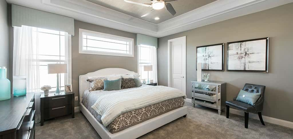 """The master bedroom is a private retreat for homeowners,"" says Perry. ""The room is tucked away, offering an added privacy to homeowners, and features two walk-in closets, a full bath and an optional bay window and tray ceiling.""<br /> <br /> Aside from the spaciousness, this master bedroom's location in the home is a highlight. Away from the home's other bedrooms, this room is still connected to the great room and other gathering areas. <br /> <br /> <strong>COURTESY OF</strong><br /> Lombardo Homes"