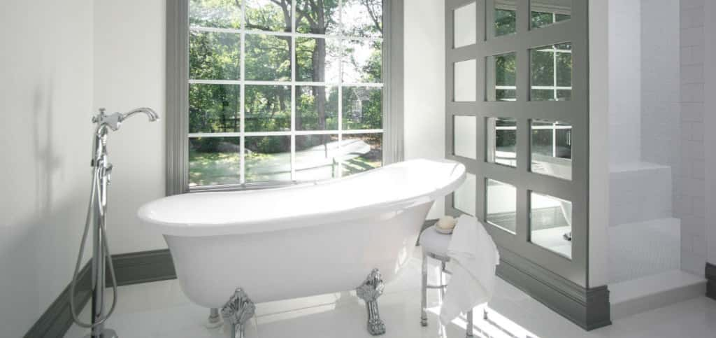 Now, this! This is what a master bathroom should be like! A clawfoot tub with tub filler is just one way to revive oneself after a long day. Or bask in the walk-in shower with body sprays that's just behind a mirrored panel wall.<br /> <br /> No matter how you bathe, this indulgent master bath is sure to be a favorite room of the home. Double vanities and lots of cabinets round out this space, ensuring clutter on your counters can be kept to a minimum.