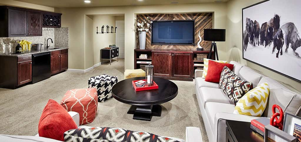 Like the feisty buffalo in the painting on the wall, you'd be giddy at having a basement such as this one in the Monaco plan by Vantage Homes. A wet bar with limestone backsplash and a wood slat accent wall are just some of the stylish features of this game room.<br /> <br /> The spacious area means you and guests can just hang on the plentiful seating in the game room, which also has unfinished storage space. Such space means holiday items such as décor, lights and more can be easily stored, without too much trouble, and means a cleaner, less cluttered home.<br /> <br /> <strong>PHOTO COURTESY OF</strong><br /> Vantage Homes