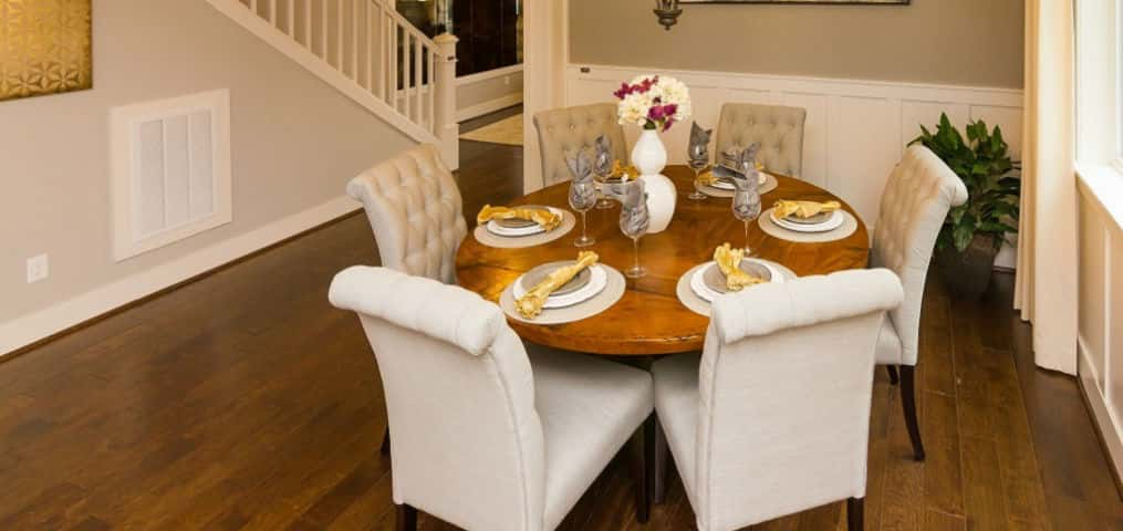 "For those who love entertaining, a formal dining room is the perfect spot for large gatherings or intimate dinner parties. In this model, the box theme room and wainscoting are standard, making it a cozy space for dining and conversation.<br /> <br /> ""A room like this is nice — especially coming up on the holidays, it's nice to have extra space for dining,"" Hudson says. ""When not entertaining, the space can be used for other things as well.""<br /> <br /> PHOTO COURTESY OF<br /> Polygon Northwest"