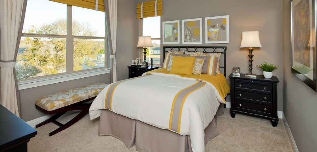 "This guest bedroom, located upstairs, provides enough space for guests to get comfy. And, if you really want to surprise visitors, you can opt for a bay window.<br /> <br /> ""Bay windows are really popular,"" Onken says. ""People really love them in the bedrooms because they're functional — you can sit in them and just look outside.""<br /> <br /> PHOTO COURTESY OF<br /> Jimmy Jacobs Custom Homes"
