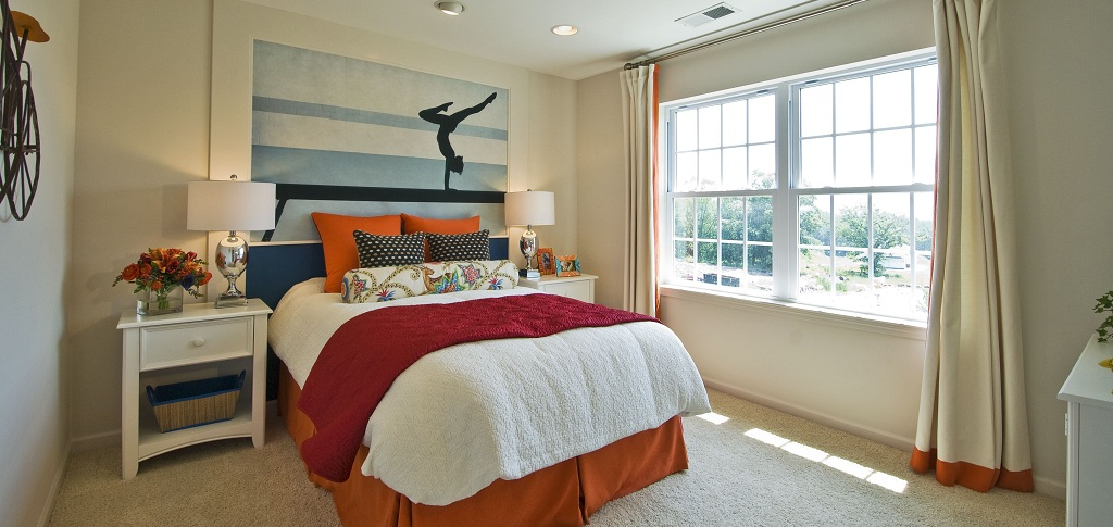 This upstairs bedroom, one of three in addition to the master, is shown here designed for a tween or teen girl. The room receives ample sunlight and comes with soft carpet underfoot, making it a perfect gathering place for friends to gab, watch movies or study. A walk-in closet offers plenty of space for a teenage girl's ever-changing and ever-growing wardrobe.<br /> <br /> PHOTO COURTESY OF<br /> Highpointe/Hornrock Properties