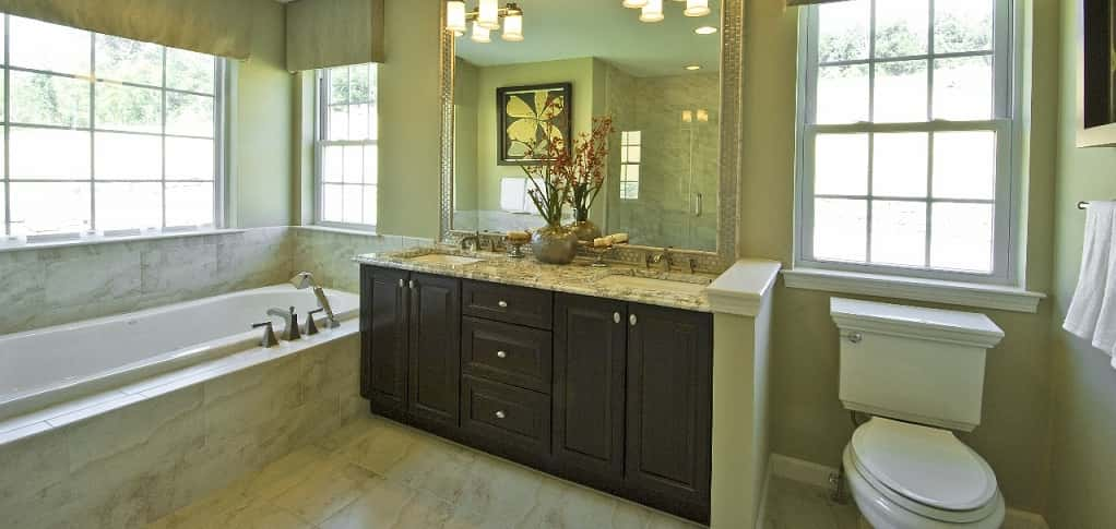 The master bath's major draw is the six-foot soaking tub that beckons homeowners after a long day at work.<br /> <br /> Spacious and bright thanks to a large tile-framed mirror and large windows, this bath includes luxurious optional design features, such as granite countertops and dual undermount sinks. The bath also includes a fully tiled shower that can be customized with upgraded fixtures to help create the homeowners' dream shower.<br /> <br /> PHOTO COURTESY OF<br /> Highpointe/Hornrock Properties<br />