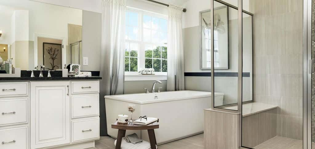A glass-encased shower with bench seat and a separate soaking tub makes for a luxurious, spa-like master bath.<br /> <br /> Double vanities ensure homeowners have space for their everyday needs, while plenty of cabinets prevent a messy look. Wouldn't it be lovely to prepare for the day in this bath? Or to soak troubles away at the end of the day?<br /> <br /> <strong>PHOTO COURTESY OF</strong><br /> Hallmark Homes Group