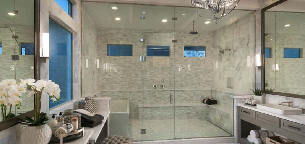 If ever there was a king of showers, this would be it. The Vista 1 Plus plan's master bath boasts a glass-encased shower with two showerheads, a bench and a white porcelain soaking tub.<br /> <br /> Dual vanities sit opposite from a vanity space, giving homeowners maximum space for primping and pampering. Large windows, along with three small windows above the shower and bathtub means plenty of sunlight, but also privacy.<br /> <br /> <strong>PHOTO COURTESY OF</strong><br /> Monterey Homes
