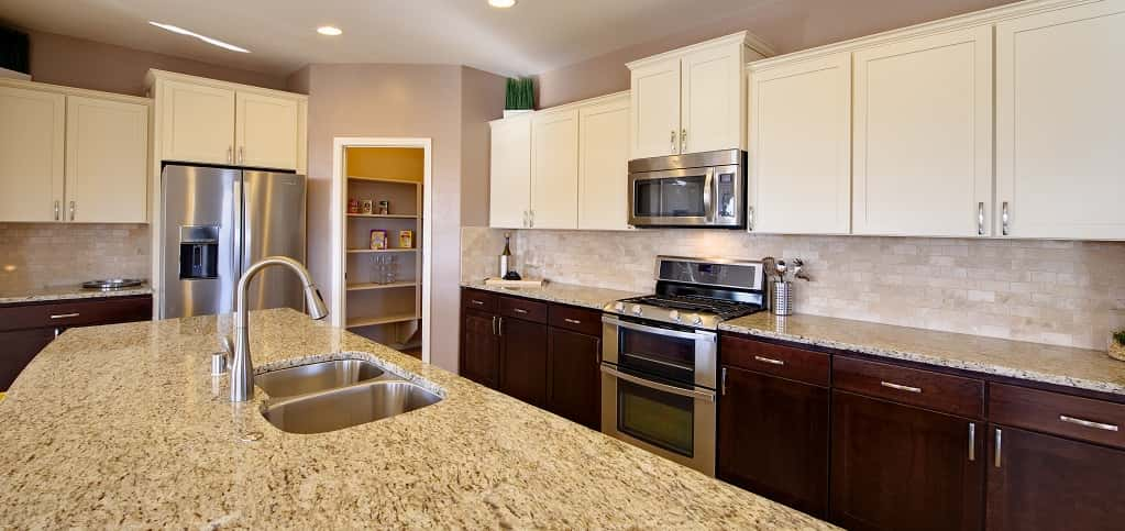 "<p>""The kitchen is the command center of the home,"" Bishop says. ""This is just a very workable and cook-friendly kitchen.""<br /> <br /> Because the kitchen work triangle — the main usage areas of the cooktop, sink and refrigerator — is important to homeowners, Abrazos Homes focused on making that space in the kitchen extremely functional, as well as on giving homeowners plenty of work and storage space, like the butler's pantry tastefully tucked away in the corner of the kitchen. ""People find the enormous amount of cabinets and counter space to be really helpful,"" Bishop says.</p> <p> </p> <p>PHOTO COURTESY OF<br /> Abrazo Homes</p>"