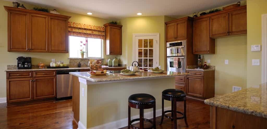 """It has a large chef's kitchen,"" Jensen says. Plenty of large cabinets and a wood floor make the kitchen both stylish and functional.<br /> <br /> A pantry with a see-through door, a large kitchen island and stainless steel appliances are the icing on the cake of this spacious kitchen.<br /> <br /> PHOTO COURTESY OF<br /> The Jones Company of Tennessee"