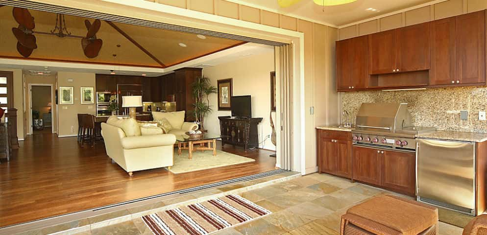"Large pocket doors connect the home's open living area to a spacious covered lanai, creating a seamless indoor/outdoor experience that brings the beauty of the island into the house.<br /> <br /> ""Hawaii's natural landscape is integrated as a central part of our design concept and floor plans at KaMilo,"" says Gorospe. ""Life on the Big Island revolves around the beauty of Hawaii, so we embrace the warm trade winds with our signature indoor/outdoor concept.""<br /> <br /> PHOTO COURTESY OF<br /> Brookfield Homes Hawaii"