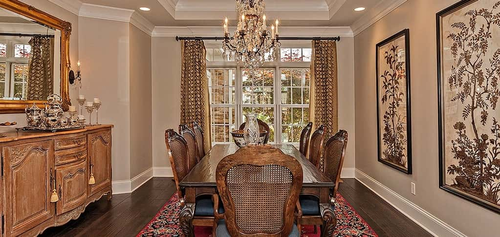 <p>A tray ceiling and rich fabrics give this dining room a regal look, just right for any formal meal you'd like to enjoy with guests.<br /> <br /> A small nook provides space for a buffet or bar space, while still providing enough space for a table with seating for eight.</p> <p> </p> <p>PHOTO COURTESY OF<br /> Larry Bloch Builders</p>