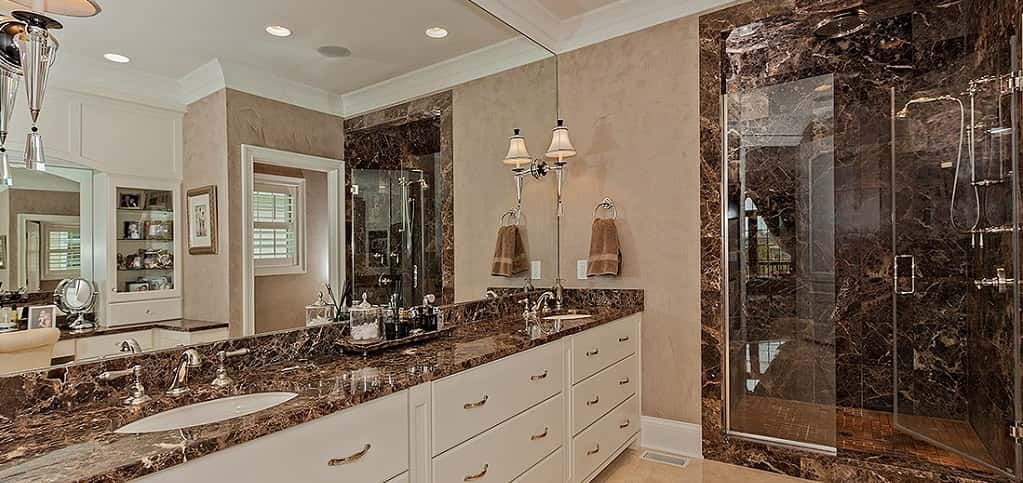 <p>A glass-encased shower and double vanities are just some of the highlights of this home's master bathroom. Heated floors are another highly sought feature.<br /> <br /> The best part of this space is the customization you can add to it to ensure it's the right kind of luxe for you.</p> <p> </p> <p>PHOTO COURTESY OF<br /> Larry Bloch Builders</p>