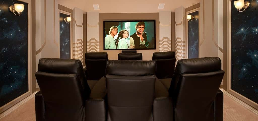 "It isn't just the awesome choice in movies that makes this media room from <a href=""https://www.newhomesource.com/builder/lennar/about/644"" target=""_blank"" title=""Lennar"">Lennar</a> so far out. It's those cozy leather recliners, those galaxy printed walls and those futuristic wall panels. Kind of feels like a spaceship, doesn't it? A media room like this could really take you out of this world!<br /> <br /> PHOTO COURTESY OF <br /> Lennar"