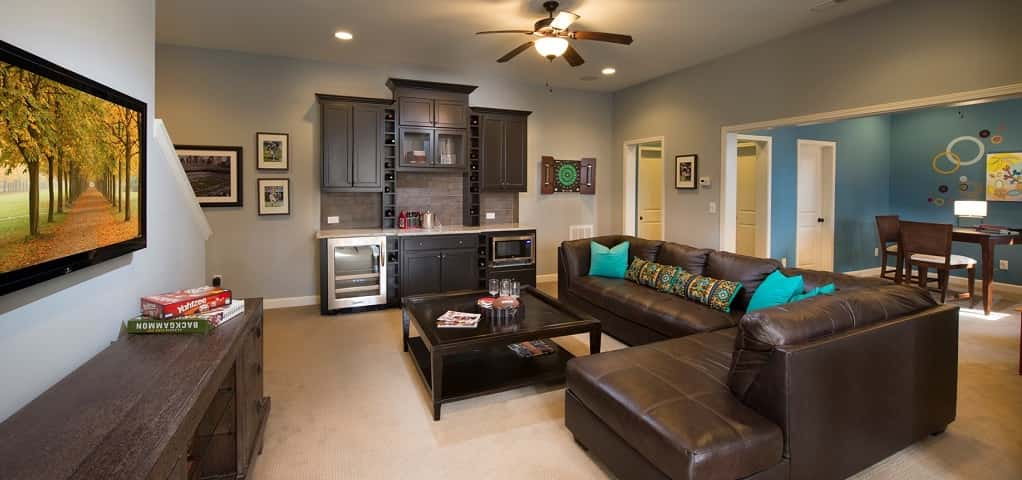 "It's easy to make your new basement a welcoming place for family and friends.<br /> <br /> Take the beautifully designed <a href=""https://www.newhomesource.com/resourcecenter/slideshows/home-of-the-week-madison-plan-by-john-wieland-homes-and-neighborhoods"" target=""_blank"" title=""See our Home of the Week profile on the Madison plan"">Madison plan</a> from John Wieland Homes and Neighborhoods in Huntersville, N.C. — cool paint colors on the wall keep this basement bright and airy, while a built-in wet bar and gaming area is the ideal space to entertain guests, young and old.<br /> <br /> PHOTO COURTESY OF<br /> John Wieland Homes and Communities"