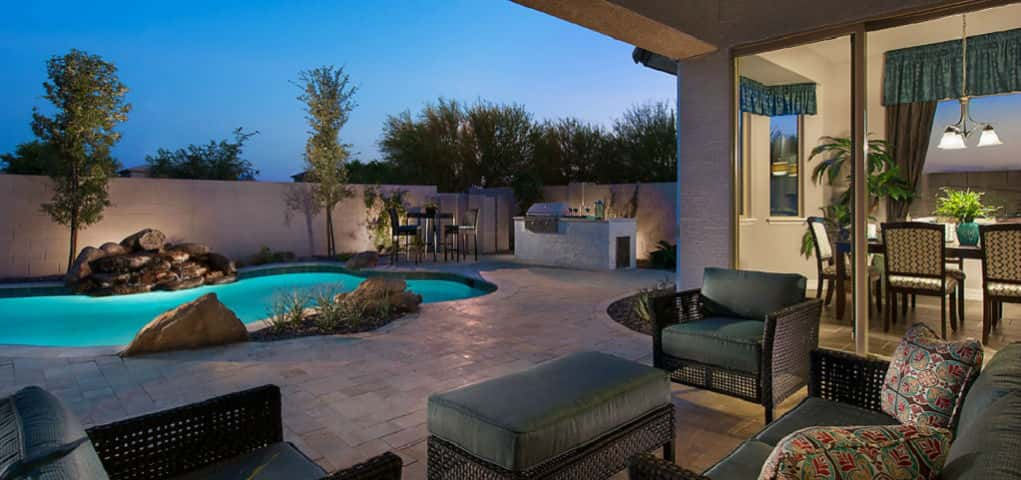 "The Hayden Plan from Artesian Ranch in Chandler, Ariz., by<a href=""http://www.newhomesource.com/builder/maracay-homes/about/1918"" target=""_blank"" title=""Learn more about Maracay Homes""> Maracay Homes</a> epitomizes the perfect balance of natural and modern elements.<br /> <br /> The boulders that accent the pond-like pool contrast with the stonework and furnishings to create a wild, contemporary style all of its own.<br /> <br /> PHOTO COURTESY OF<br /> Maracay Homes"