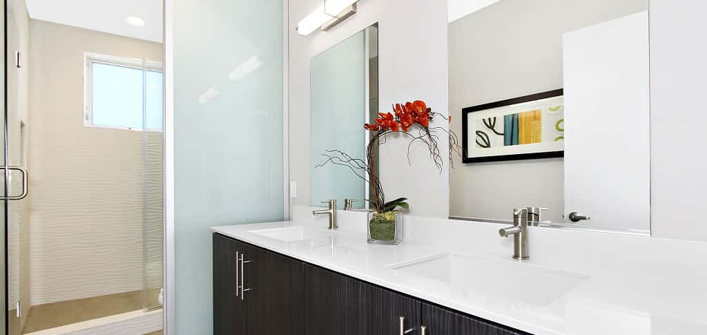 A spacious and modern master bath is the ideal complement to the Panorama community's sleek, hip feel.<br /> <br /> The master baths come complete with E-stone slab countertops, dual undermount rectangular sinks and an elongated dual-flush toilet, ensuring you can prepare for the day and save energy and water.<br /> <br /> PHOTO COURTESY OF<br /> WCH Communities