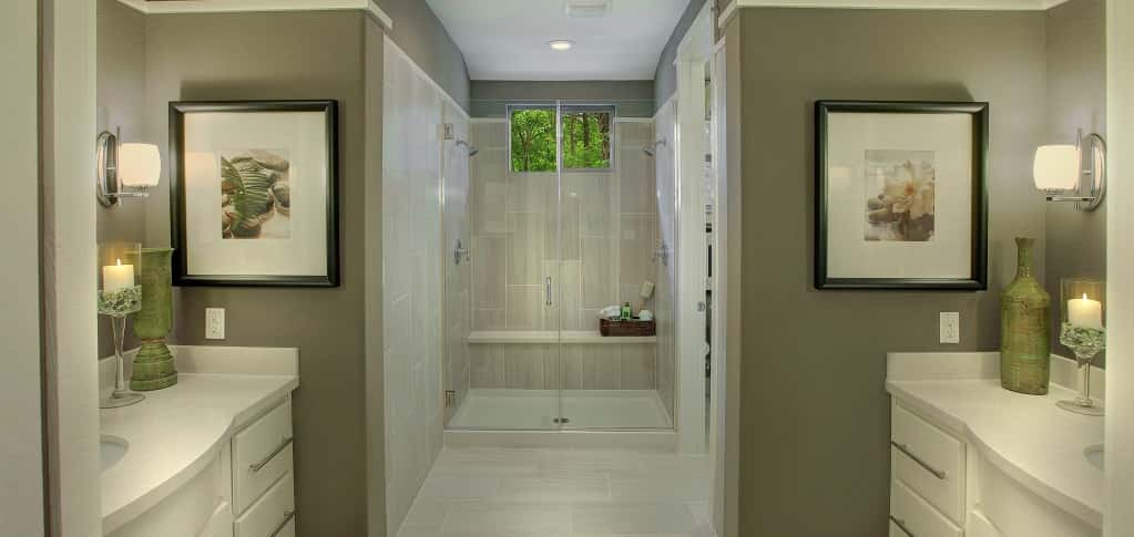 "<p>""My favorite room in the home is the master bath,"" says Decker. ""It truly feels like going to the spa. It's a retreat."" <br /> <br /> Featuring dramatic floating his-and-hers vanities, a frameless, glass-enclosed shower with dual shower heads and two (yes, two!) walk-in closets, the master en suite is the ultimate in elegant sophistication. Here, relaxation is inevitable.</p> <p> </p> <p>PHOTO COURTESY OF<br /> Ash Creek Homes</p>"