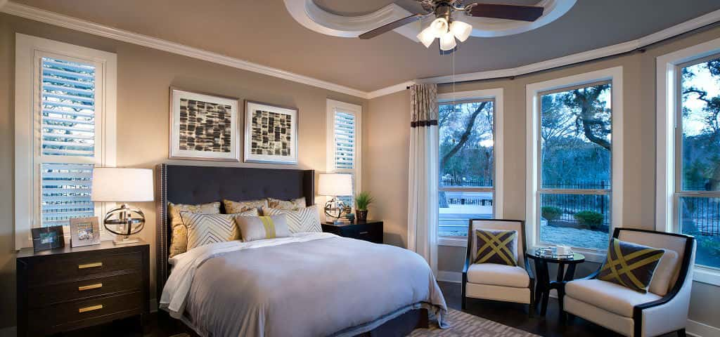 The master bedroom's ample size is one of its main selling points. However, it's the beautiful bow that's the centerpiece of the room and increases the room's square footage while featuring four or the room's six large windows overlooking the backyard, Harris says. <br /> <br /> A detailed coffered ceiling and rich chocolate details make this room a desirable evening retreat.<br /> <br /> PHOTO COURTESY OF<br /> Standard Pacific Homes