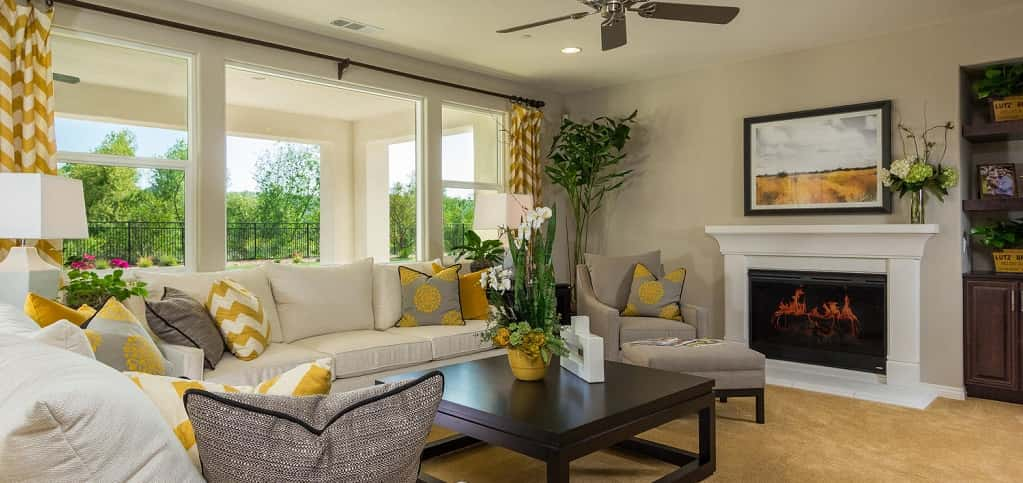 "Who wouldn't want to spend time in an airy, light-filled room? A bank of windows in the home's family room brings in natural sunlight while still being intimate. The open floor plan means this room allows continuity with the home's kitchen.<br /> <br /> ""You can have a cozy space where everyone can be connected,"" Brozio says. ""You can be cooking in the kitchen while the kids are in the family room coloring or watching TV, yet everyone's still together.""<br /> <br /> PHOTO COURTESY OF<br /> Michael Gregory Builders"