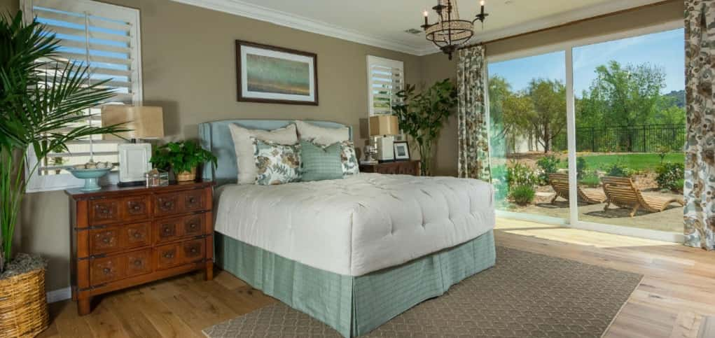 Thoughtfully designed to create a restful retreat, the home's master bedroom is spacious and airy. A large glass sliding door allows easy access to an optional loggia, while two windows are strategically spaced for placement of a king bed.<br /> <br /> The master suite includes a spacious master bath with an expansive walk-in closet and separate vanities.<br /> <br /> PHOTO COURTESY OF<br /> Michael Gregory Builders