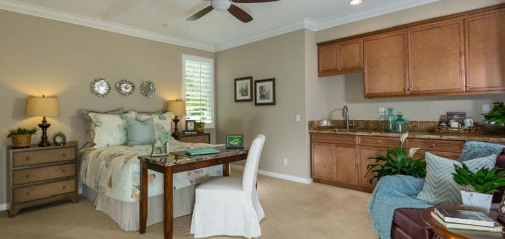 What would an entertainer's home be without an optional guest suite? Decked out with more than just a place to rest while away from home, the guest suite includes a wet bar that can be substituted as a snack or coffee bar.<br /> <br /> For those who don't have many guests, the space can be an optional office that includes a walk-in closet and full bath.<br /> <br /> PHOTO COURTESY OF<br /> Michael Gregory Builders