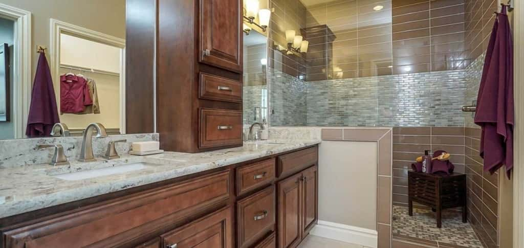 "Luxury never goes out of style. Just check out this master bathroom in the <a href=""https://www.newhomesource.com/homedetail/planid-1191201"" target=""_blank"" title=""See More Photos of the Griffith plan"">Griffith plan</a> by Oakwood Homes in Farmington, Utah.<br /> <br /> Double vanities and a walk-in shower with a partial-glass enclosure ensure luxury abounds in this three-bedroom, two-and-a-half bathroom townhome. If a townhome is not your style – but low/no maintenance is – don't worry. Oakwood Homes offers single-family floor plans at the Avenues at the Station.<br /> <br /> Photo Courtesy of<br /> Oakwood Homes"