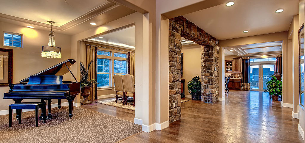 The Broadmoor allows for plenty of personalizing touches and upgrades, such as this beautiful stone archway framing the dining room. The open floor plan allows for easy interaction between rooms, ensuring that your family is able to stay comfortably connected.<br /> <br /> Oakwood Homes is an energy-efficient builder that adheres to Energy Star standards and third-party tests each home.<br /> <br /> PHOTO COURTESY OF<br /> Oakwood Homes