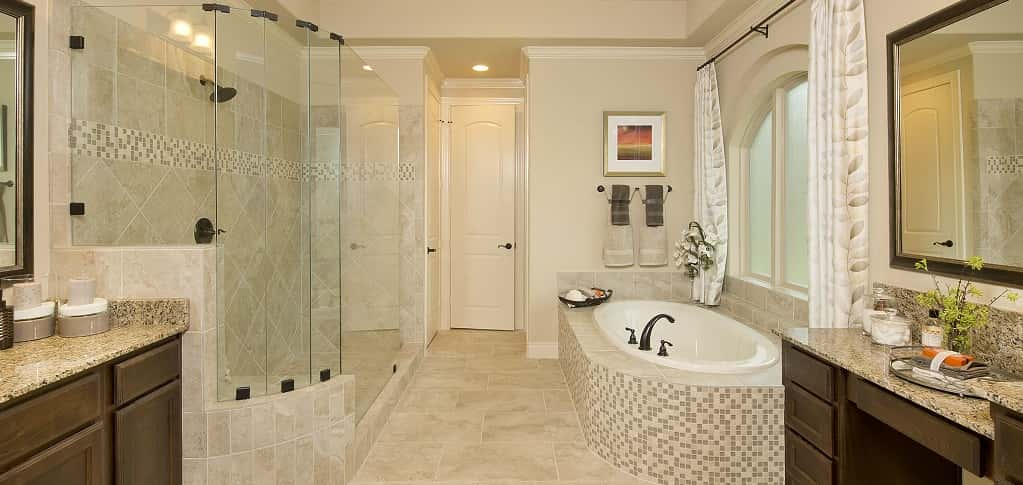 Not to be outdone by the master bedroom, the impressive en suite is loaded with all of the necessary components of a luxuriant day spa. <br /> <br /> Here, his-and-hers vanities, granite counter tops, framed mirrors, a glass encased standing shower, a separate garden tub, and two — yes, two! — walk-in closets all come together to create a room that leaves little to be desired.<br /> <br /> PHOTO COURTESY OF<br /> Perry Homes