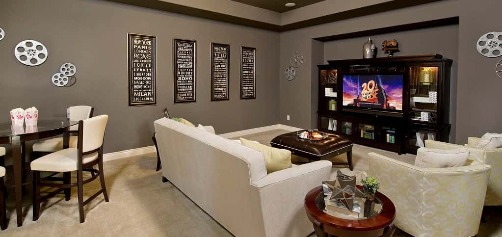 "We can! Who wouldn't after catching a glimpse of this classic cinema-themed media room from <a href=""https://www.newhomesource.com/communitydetail/builder-68/community-64206"" target=""_blank"" title=""Perry Homes"">Perry Homes</a>? Toss up a few film rolls, maybe a couple of your favorite movie posters, and any other cinematic knickknacks you can find and you could easily reproduce this style. Add in a great entertainment center nook and you've got the perfect movie night cave.<br /> <br /> PHOTO COURTESY OF<br /> Perry Homes"